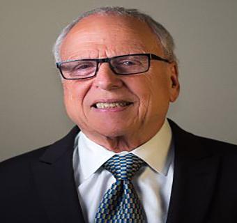 Dr. Eugene Schneller